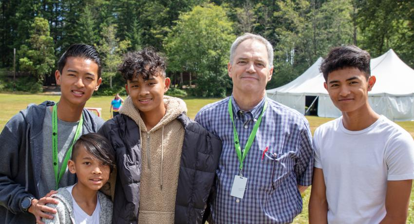 DCYF Secretary Ross Hunter with siblings at Camp To Belong