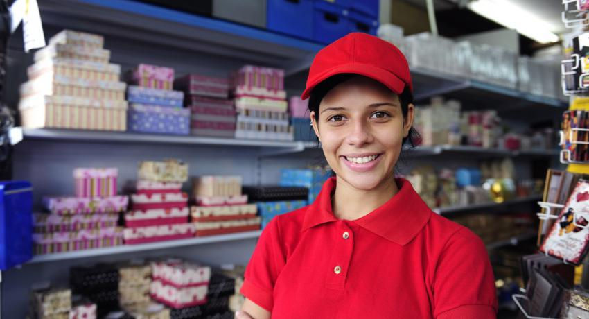 Young woman working in a retail setting.